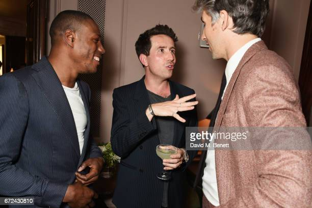 Tafari Hinds Nick Grimshaw and George Lamb attend the NetaPorter Mr Porter preopening dinner cohosted by Jenny Dickinson and Jeremy Langmead in The...