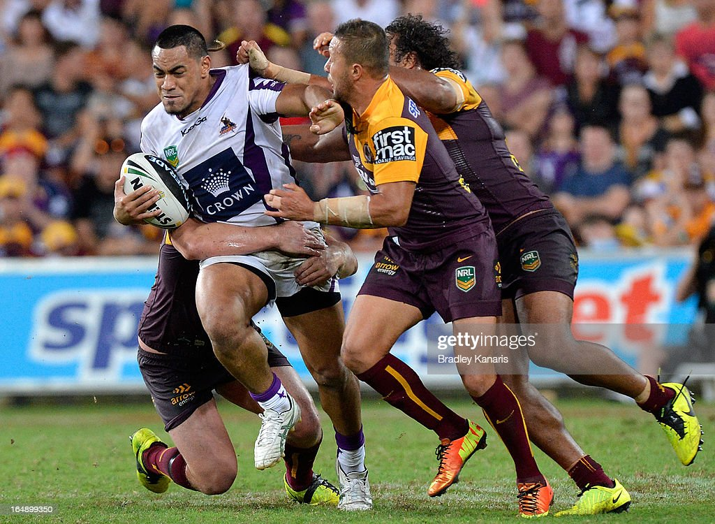 Tafeaga Junior Sa'u of the Storm is tackled during the round four NRL match between the Brisbane Broncos and the Melbourne Storm at Suncorp Stadium on March 29, 2013 in Brisbane, Australia.