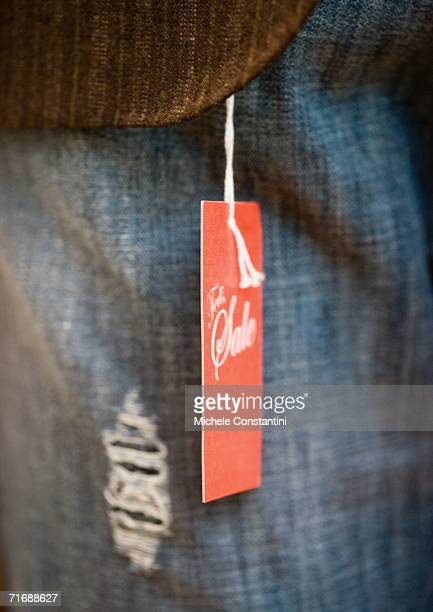 Tag attached to article of clothing, close-up