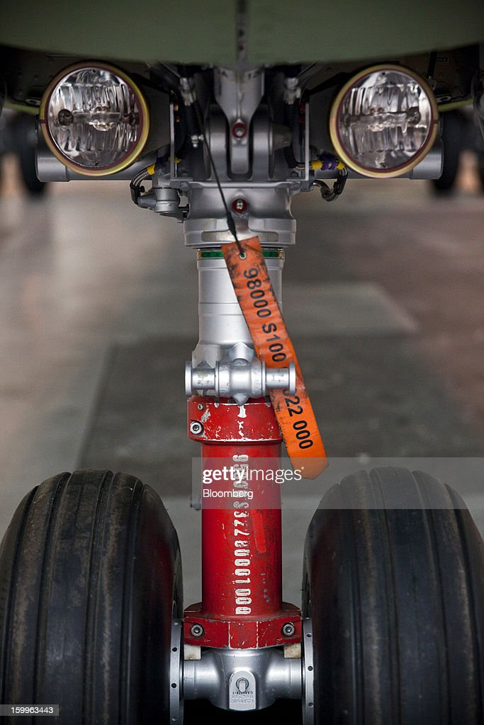 A tag hangs from the landing gear of a ATR-72 turboprop aircraft, manufactured by Avions de Transport Regional (ATR), under construction at the company's production facility in Colomiers, France, on Wednesday, Jan. 23, 2013. ATR, the world's largest maker of turbo-propeller airliners, reported record profit for 2012, even as it fell short of its shipment target amid production delays. Photographer: Balint Porneczi/Bloomberg via Getty Images