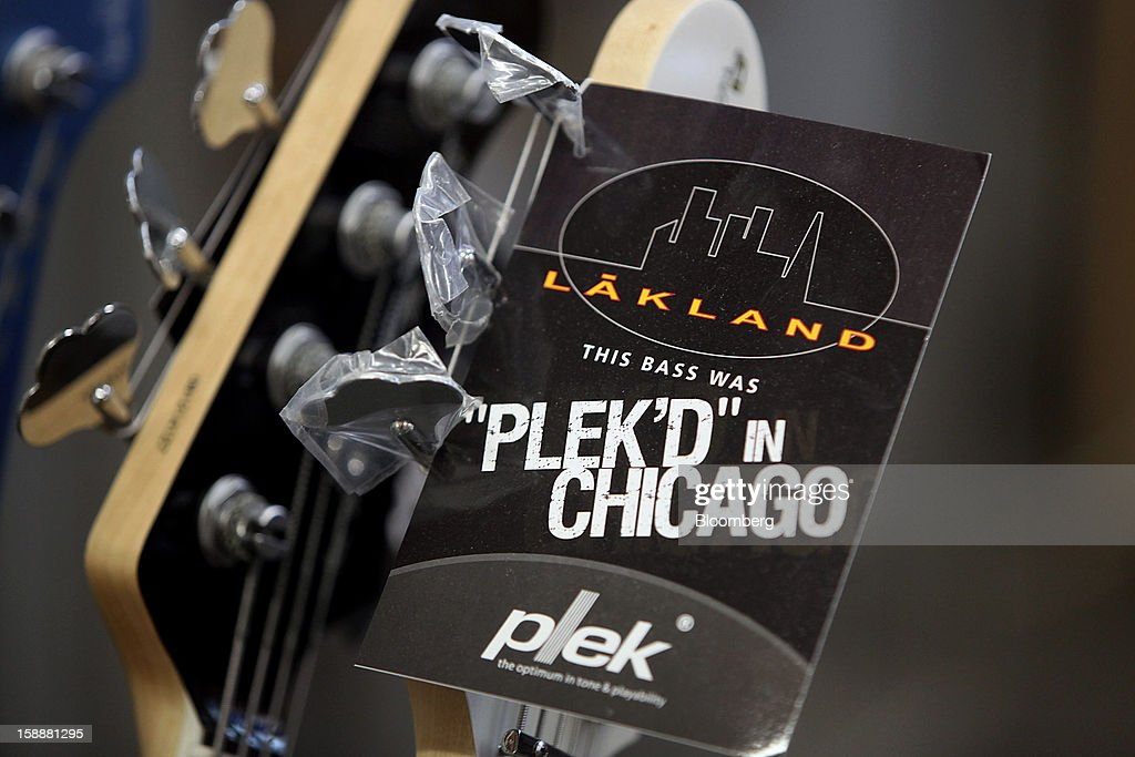 A tag is seen on a Lakland bass guitar neck after the computerized fret dressing (PLEK) at the company's production facility in Chicago, Illinois, U.S., on Thursday, Dec. 27, 2012. Manufacturing picked up in December, reflecting growth in orders, employment and exports that indicate the U.S. expansion will be sustained in 2013 following the budget deal. Photographer: Tim Boyle/Bloomberg via Getty Images