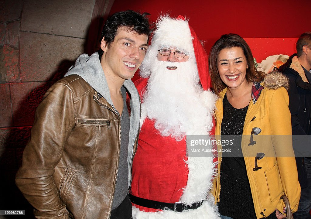 Taïg Khris and Guest and Karima Charni poses at the Coca Cola Christmas windows inauguration at Le Showcase on November 26, 2012 in Paris, France.