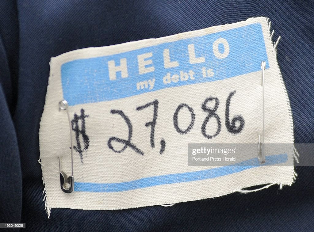A tag worn by Jacob Lowry a student at the University of Southern Maine as he and others protest student debt at Monument Square in Portland...