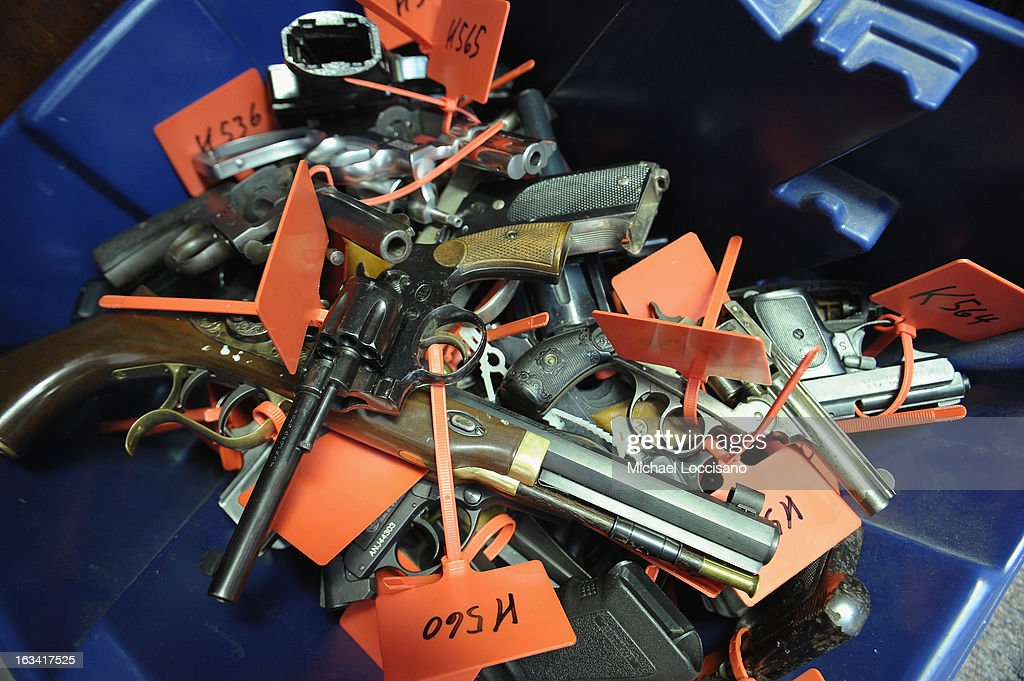 Tagged handguns lay in a bucket during a gun buyback program on March 9, 2013 in Keansburg, New Jersey. In a national effort to curb gun violence, the NJ Attorney General's Office in cooperation with the Monmouth County Prosecutor's Office held an anonymous buyback program where every gun turned in is to be melted down.