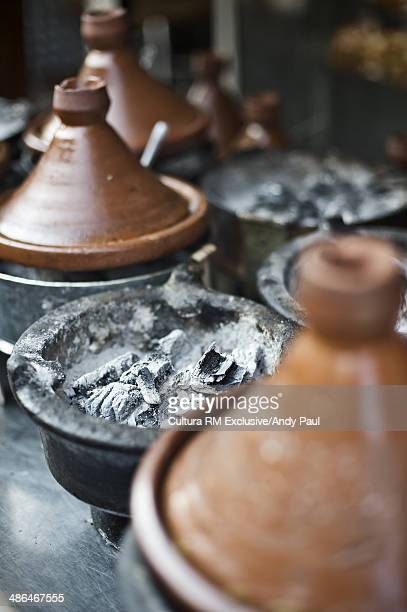 Tagines cooking on charcoal in street, Casablanca, Morocco