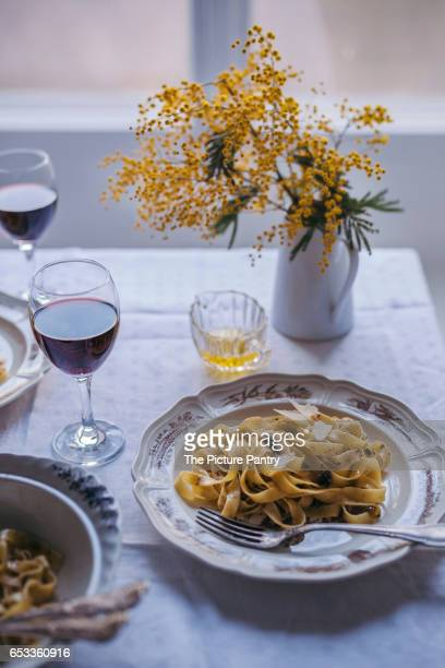 Tagliatelle pasta with black truffle in a vintage bowl