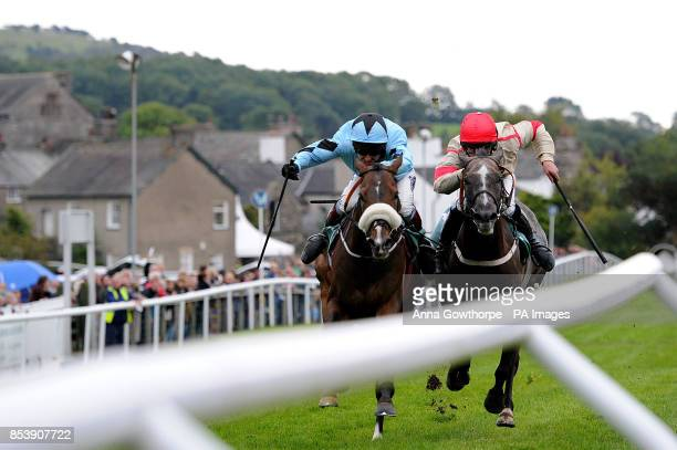 Taglietelle ridden by Richard Johnson beats Poetic Verse ridden by Dean Pratt to win the Swan Hotel and Spa Novices' Hurdle at Cartmel Racecourse...