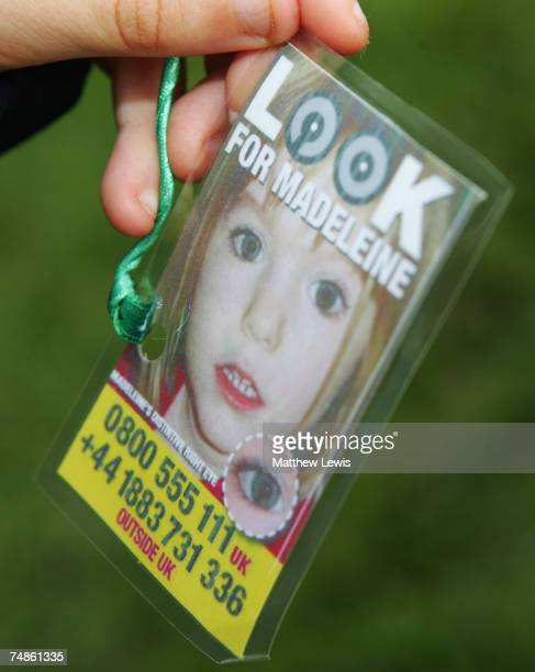 Tags displaying photographs of Madeleine McCann are tied to balloons in Bradgate Park on June 22 2007 in Leicester England Balloons are being freed...