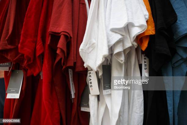 Tags hang from clothing displayed for sale at a Sears Canada Inc store inside a mall in Toronto Ontario Canada on Thursday June 22 2017 Canadian...