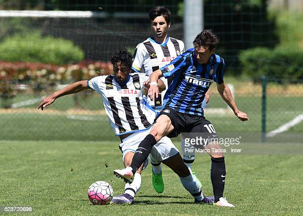 Taha Ben Hezzedi Maghzaoui of Udinese Calcio competes for the ball with Enrico Baldini of FC Internazionale during the juvenile match between FC...