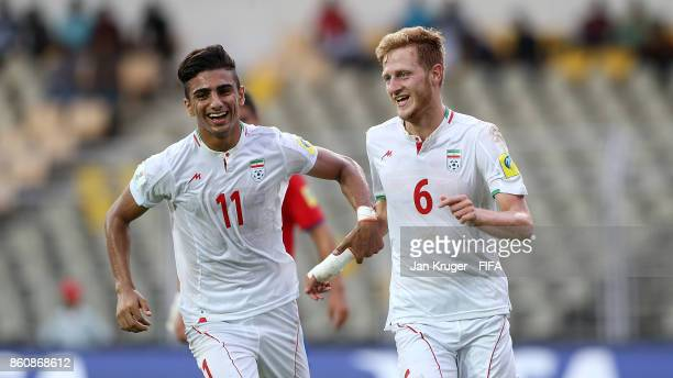 Taha Shariati of Iran celebrates scoring the second goal from the penalty spot during the FIFA U17 World Cup India 2017 group C match between Costa...