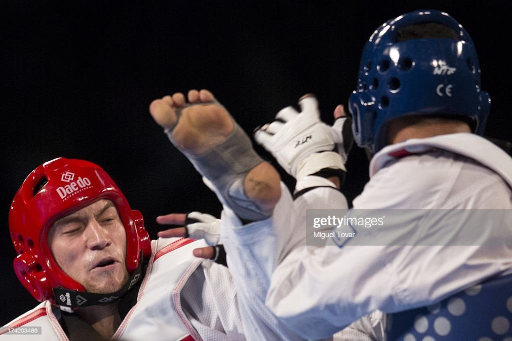 Tahir Guelec of Germany (blue) compete with Anton Kotkov of Rusia during the men's -80 kg semifinal combat of WTF World Taekwondo Championships 2013 at the exhibitions Center on July 21, 2013 in Puebla, Mexico.