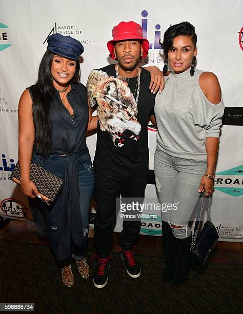 Tahiry Jose Ludacris and Laura Govan attend LudaDay Weekend Celebrity Bowling Tournament at Bowlmar Lanes on September 2 2016 in Atlanta Georgia