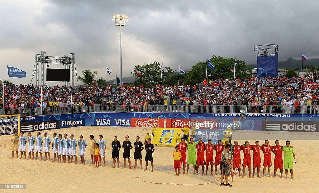 Tahiti and Argentina line up for the national anthems ahead of the FIFA Beach Soccer World Cup Tahiti 2013 Quarter Final match between Argentina and Tahiti at the Tahua To'ata Stadium on September 25, 2013 in Papeete, French Polynesia.