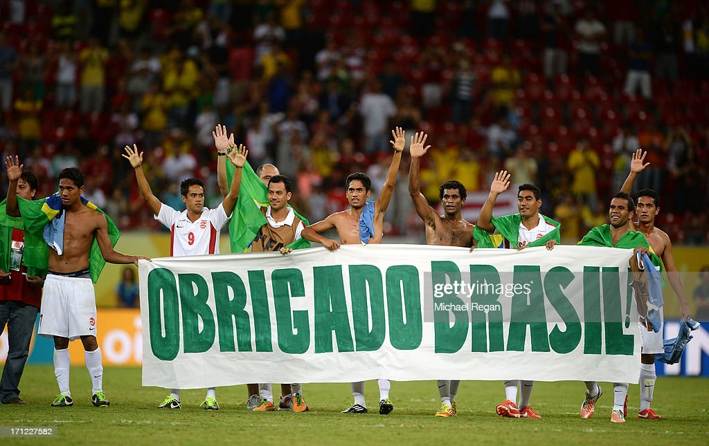 Tahiti holds up a sign reading 'Obrigado Brasil' after the FIFA Confederations Cup Brazil 2013 Group B match between Uruguay and Tahiti at Arena Pernambuco on June 22, 2013 in Recife, Brazil.