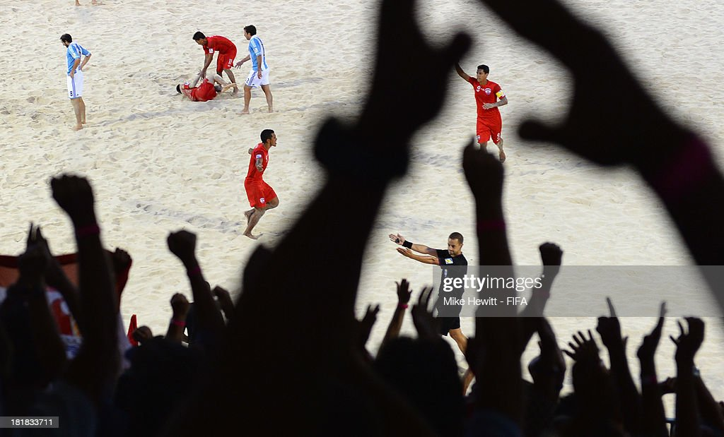 Tahitian fans celebrate after the goal from Heimanu Taiarui of Tahiti (centre left) during the FIFA Beach Soccer World Cup Tahiti 2013 Quarter Final match between Argentina and Tahiti at the Tahua To'ata Stadium on September 25, 2013 in Papeete, French Polynesia.