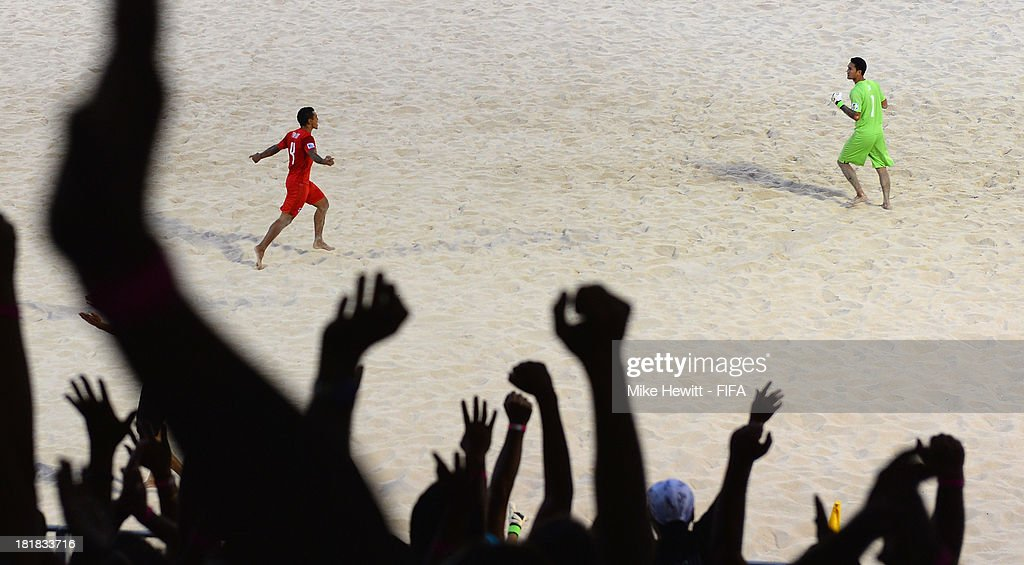 Tahitian fans celebrate as goalscorer Heimanu Taiarui of Tahiti (centre left) runs to celebrate with goalkeeper Jonathan Torohia during the FIFA Beach Soccer World Cup Tahiti 2013 Quarter Final match between Argentina and Tahiti at the Tahua To'ata Stadium on September 25, 2013 in Papeete, French Polynesia.