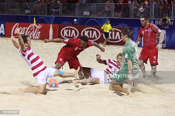 Tahiti's Patrick Tepa fights for the ball with United States' Lewie Valentine and Nicolas Perera before US goalkeeper Christopher Toth on September...