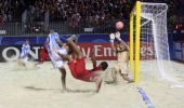Tahiti's Raimoana Bennett scores against Argentina on September 25 2013 during a 2013 FIFA beach soccer World Cup quarterfinal match in Papeete on...
