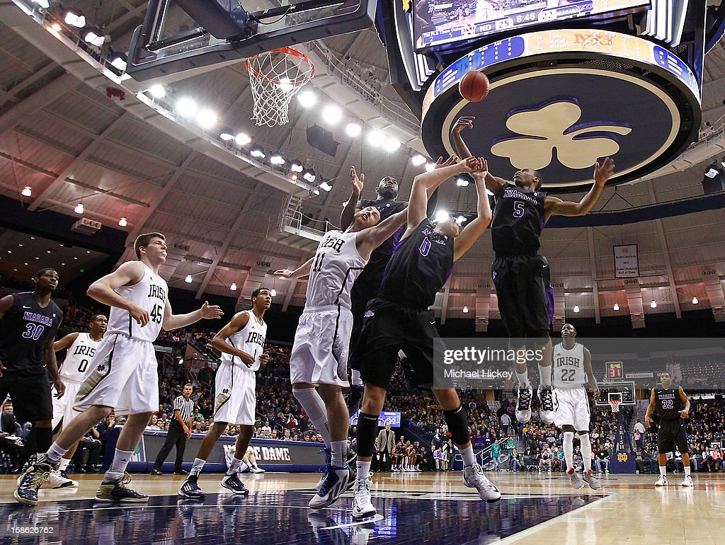 Tahjere McCall #5 of the Niagara Purple Eagles and grabs for a rebound against the Notre Dame Fighting Irish at Purcel Pavilion on December 21, 2012 in South Bend, Indiana.
