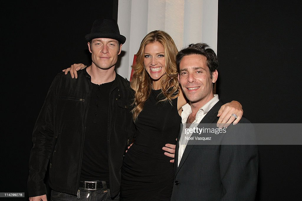 Tahmoh Penikett, <a gi-track='captionPersonalityLinkClicked' href=/galleries/search?phrase=Tricia+Helfer&family=editorial&specificpeople=227945 ng-click='$event.stopPropagation()'>Tricia Helfer</a> and James Callis attend her Maxim Cover Party hosted by SBE at Mi-6 Night club on October 20, 2009 in West Hollywood, California.