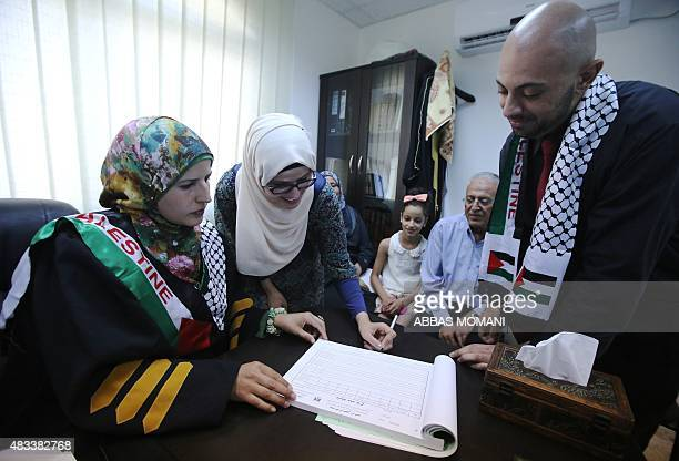 Tahrir Hamad the first Palestinian woman justice of the peace pronounces Thaer and Rawan man and wife at the Islamic sharia law court in the West...