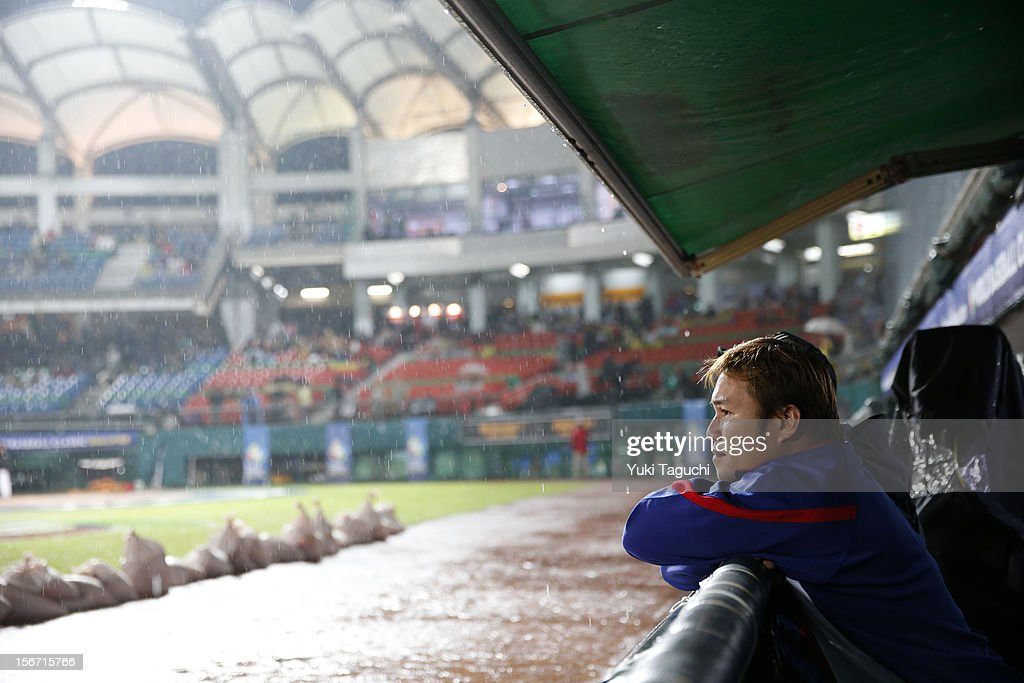 Ta-Hung Cheng #7 of Team Chinese Taipei looks on from the dugout before Game 6 of the 2013 World Baseball Classic Qualifier against Team New Zealand at Xinzhuang Stadium in New Taipei City, Taiwan on Sunday, November 18, 2012.