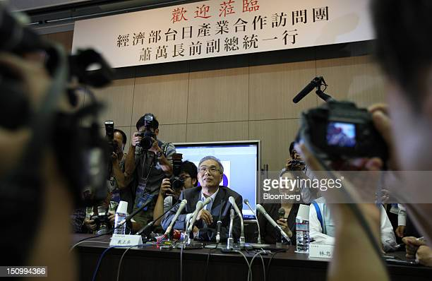 Tai JengWu vice chairman of Hon Hai Precision Industry Co center speaks during a news conference at the Sakai Display Products Corp plant in Sakai...
