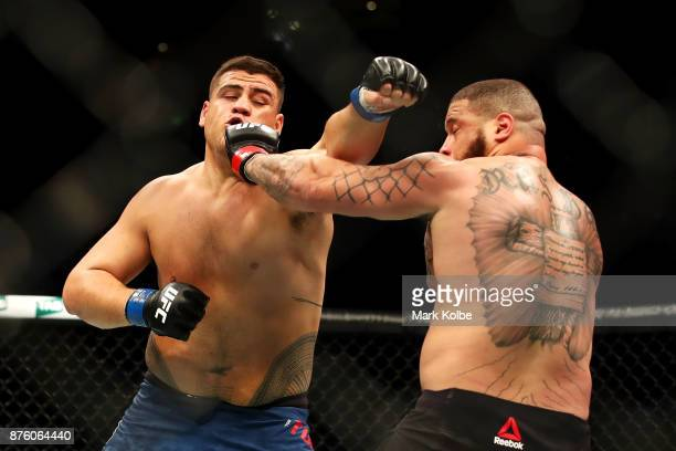 Tai Tuivasa of Australia punches Rashad Coulter of the USA in their heavyweight bout during the UFC Fight Night at Qudos Bank Arena on November 19...