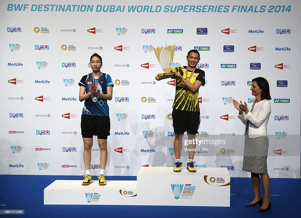<a gi-track='captionPersonalityLinkClicked' href=/galleries/search?phrase=Tai+Tzu+Ying&family=editorial&specificpeople=7058950 ng-click='$event.stopPropagation()'>Tai Tzu Ying</a> of Chinese Taipai is presented the trophy by Giselle Pettyfer, Vice Chairman, Falcon and Associates as Sung Ji Hyun of Korea applauds after the Women's Singles Final on day five of the BWF Destination Dubai World Superseries Finals at the Hamdan Sports Complex on December 21, 2014 in Dubai, United Arab Emirates.