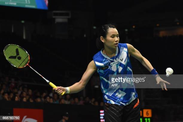 Tai TzuYing of Taiwan plays against Beiwen Zhang of the US during the women's singles semifinal of the Singapore Open badminton tournament in...