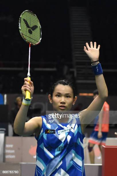 Tai TzuYing of Taiwan reacts after beating Beiwen Zhang of the US during the women's singles semifinal of the Singapore Open badminton tournament in...