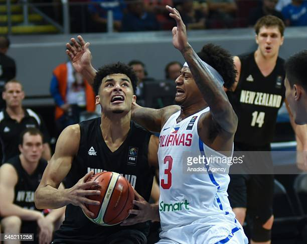 Tai Webster looks to shoot the ball as Bobby Ray Parks of the Philippines attempts to stop him during their match for the FIBA 2016 Olympic...