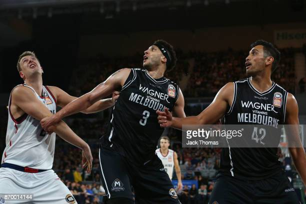 Tai Wesley and Josh Boone of Melbourne United compete from a rebound aginst Daniel Johnson of the Adelaide 36ers during the round five NBL match...