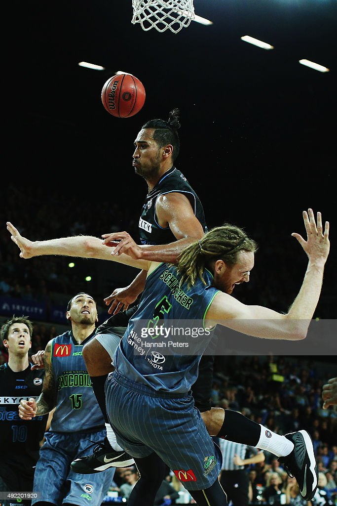 Tai Wesley of the Breakers falls over the top of Luke Schenscher of the Crocodiles during the round one NBL match between the New Zealand Breakers...