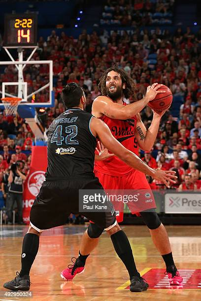 Tai Wesley of the Breakers holds out Matt Knight of the Wildcats during the round two NBL match between the Perth Wildcats and the New Zealand...