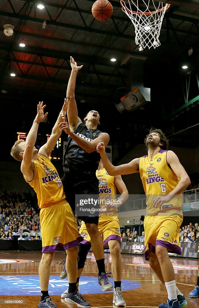 Tai Wesley shoots for the Breakers (C) with Kings players Julian Khazzouh (R) and Rhys Carter (L) in defence during the round three NBL match between the New Zealand Breakers and the Sydney Kings at North Shore Events Centre on October 21, 2015 in Auckland, New Zealand.