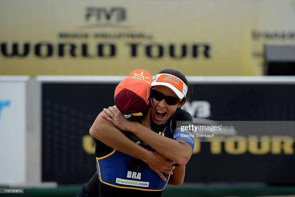Taiana Lima (L) and Talita Da Rocha Antunes (R) of Brazil celebrate winning their match being 1st during the FIVB Grand Slam final match day at The Hague Beach Stadium on June 16, 2013 in The Hague, Netherlands.