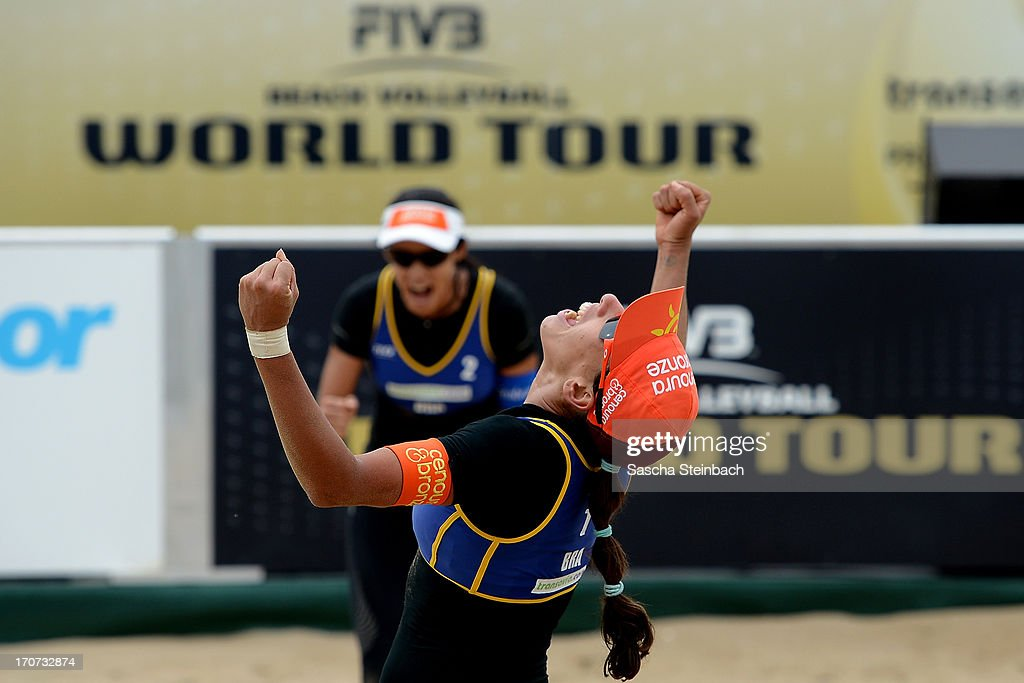 Taiana Lima (R) and Talita Da Rocha Antunes (L) of Brazil celebrate winning their match being 1st during the FIVB Grand Slam final match day at The Hague Beach Stadium on June 16, 2013 in The Hague, Netherlands.