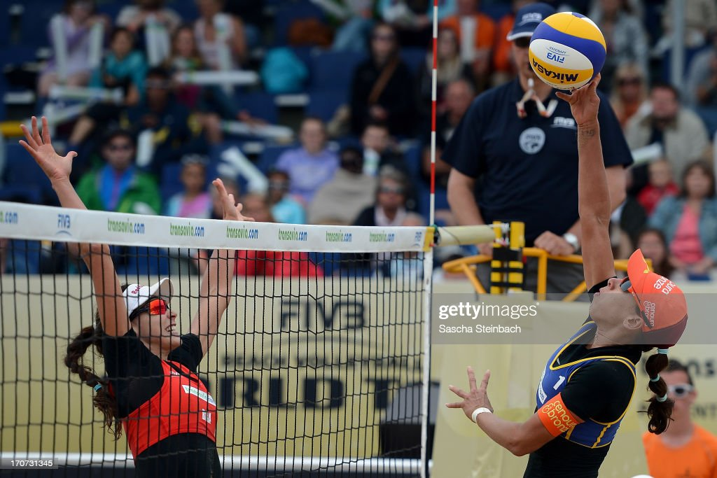 Taiana Lima (R) of Brazil vies with Maria Clara Salgado Rufino (L) of Brazil during the FIVB Grand Slam final match day at The Hague Beach Stadium on June 16, 2013 in The Hague, Netherlands.