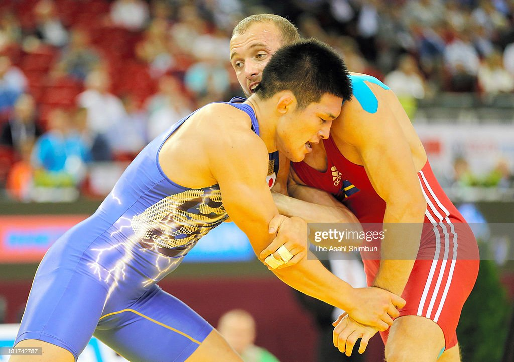 Taichi Oka of Japan and Fisnik Zahiti of Sweden compete in the Men's 84kg GrecoRoman second round during day six of the FILA Wrestling World...
