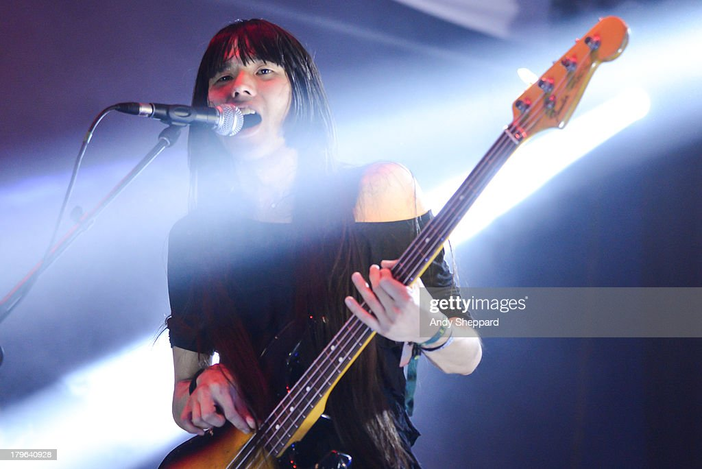 Taigen Kawabe of Japanese acid punk band Bo Ningen performs on stage on Day 3 of End Of The Road Festival 2013 at Larmer Tree Gardens on September 1, 2013 in Salisbury, England.