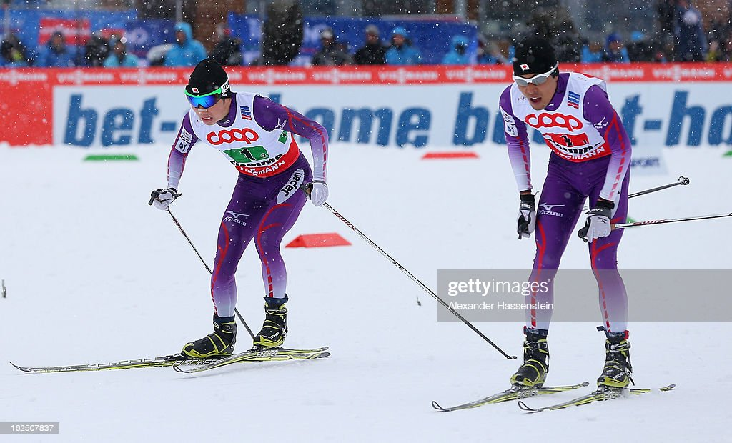 Taihei Kato (l) and Yoshito Watabe of Japan compete during the Nordic Combined Team 4x5km at the FIS Nordic World Ski Championships on February 24, 2013 in Val di Fiemme, Italy.