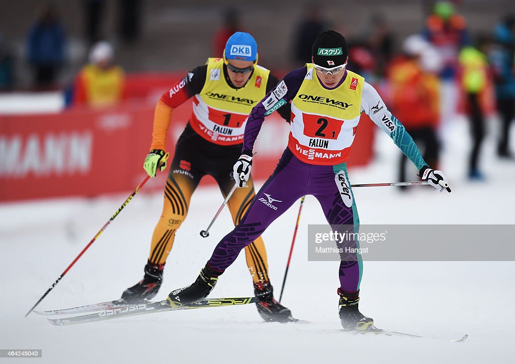 Taihei Kato of Japan competes with Tino Edelmann of Germany during the Nordic Combined 4 x 5km Cross-Country team event during the FIS Nordic World Ski Championships at the Lugnet venue on February 22, 2015 in Falun, Sweden.