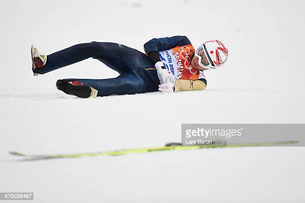 Taihei Kato of Japan crashes as he competes in the Nordic Combined Men's Individual LH during day 11 of the Sochi 2014 Winter Olympics at RusSki...