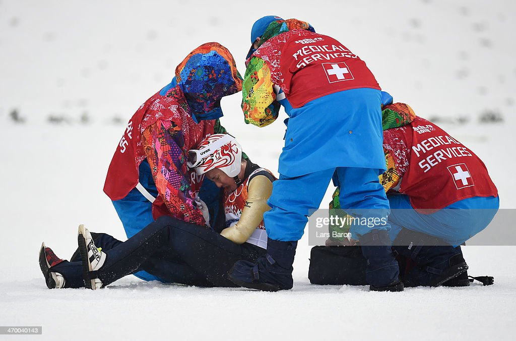 <a gi-track='captionPersonalityLinkClicked' href=/galleries/search?phrase=Taihei+Kato&family=editorial&specificpeople=4855042 ng-click='$event.stopPropagation()'>Taihei Kato</a> of Japan receives assistance after crashing in the Nordic Combined Men's Individual LH during day 11 of the Sochi 2014 Winter Olympics at RusSki Gorki Jumping Center on February 18, 2014 in Sochi, Russia.