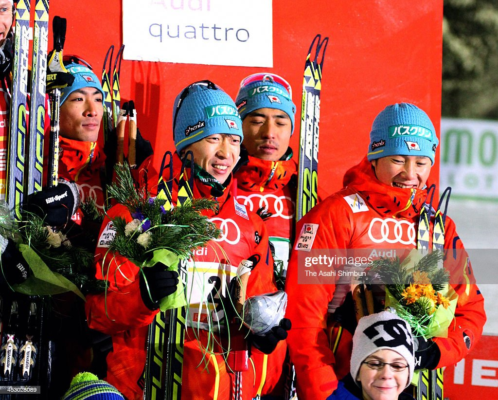 Taihei Kato, Yosihito Watabe, Hideaki Nagai and Akito Watabe of Japan celebrate the third place of Nordic Combined relay at FIS World Cup Ruka Nordic Opening on December 1, 2013 in Kuusamo, Finland.