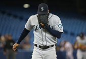 Taijuan Walker of the Seattle Mariners reacts after getting the last out of the eighth inning during MLB game action against the Toronto Blue Jays on...