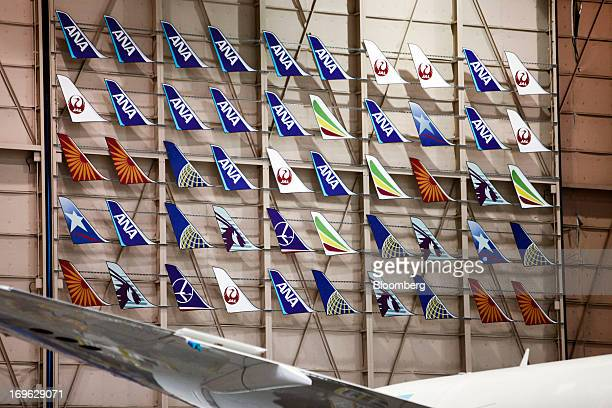 Tail fin emblems for the Boeing Co 787 Dreamliner with logos of various airlines including All Nippon Airways Co Japan Airlines Co and United...