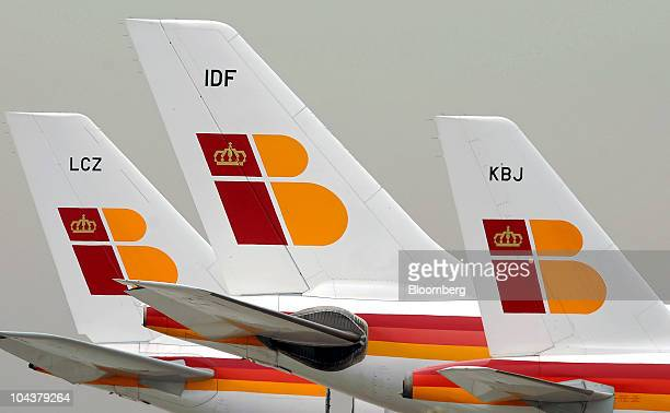 Tail fins of Iberia Lineas Aereas de Espagna SA aircraft are seen at the T4 terminal of Barajas airport in Madrid Spain on Thursday Sept 23 2010...